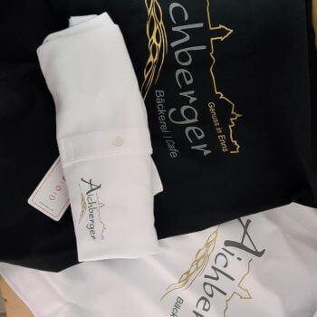 Bäckerei Aichberger Hemden, Schürzen und T-Shits bedruckt mit Logo